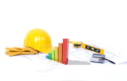 Construction growth. Concept for growth on construction a 3d graph of growth on blueprints Royalty Free Stock Image