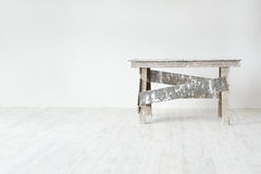 Construction grunge ladder  in white interior Royalty Free Stock Photography