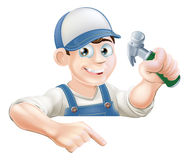 Construction guy pointing at banner Royalty Free Stock Image