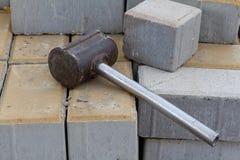 Construction hammer on bricks at a construction site Stock Photos