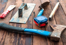 Construction hand tools. Over wooden floor Royalty Free Stock Photos
