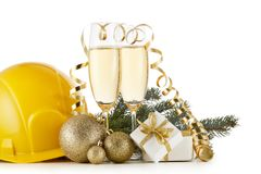 Construction hard hat, fir tree branches, two glasses with champange and Christmas ornament isolated on a white background. New. Year and Christmas. Horizontal stock photos