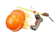 Construction hard hat, roulette, gloves, drill Royalty Free Stock Photography