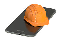 Construction Hard Hat and Smartphone, service and repair concept Royalty Free Stock Photo