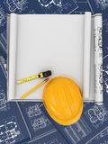 Construction. Hardhat, blueprint and rulers. Stock Image