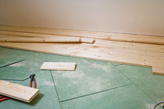 Construction of hardwood floor. In a house Stock Photos
