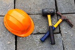 Construction hat and hammers Stock Photos