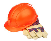 A construction hat and heavy duty gloves royalty free stock photos