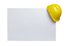 Construction helmet. Close up of  a yellow construction helmet on white blank note white background with clipping path Royalty Free Stock Photography