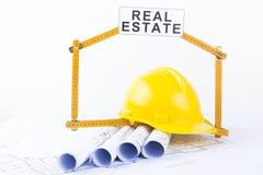 Construction helmet and architect`s rolls. Construction tools and architect`s rolls on white Royalty Free Stock Photos