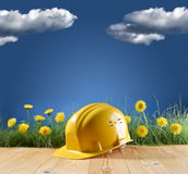Construction helmet on blue nature background Stock Photo