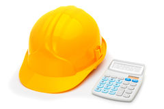 Construction helmet with calculator on white Royalty Free Stock Photography