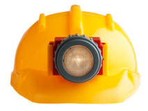 Construction helmet with a flashlight Stock Photo