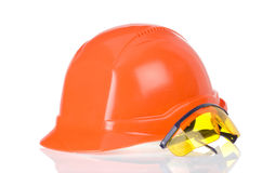 Construction helmet and glass tool on white Royalty Free Stock Image