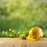 Construction helmet on green nature background Stock Photography