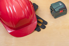 Construction helmet and laser level Stock Photography