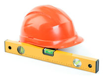 Construction helmet and level Stock Photography