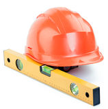 Construction helmet and level Royalty Free Stock Images