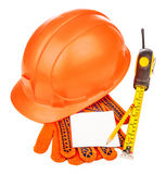 Construction helmet with measure tape and gloves Stock Images