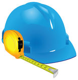Construction helmet and measuring tape Royalty Free Stock Photo