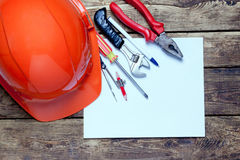 Construction helmet, old tools and Royalty Free Stock Photography