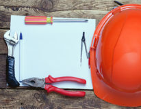 Construction helmet, old tools and Stock Photography