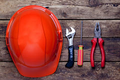 Construction helmet and old tools Stock Photography