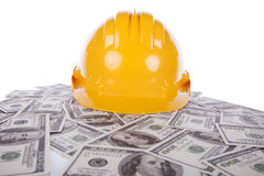 Construction helmet over a lot of money Stock Photo