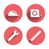 Construction helmet and ruler, roulette icons. Construction helmet and wrench key tool icons. Ruler and tape measure roulette sign symbols. Pink circles flat Stock Photos