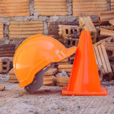 Construction helmet safety and cone in construction site Royalty Free Stock Photography