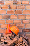 Construction helmet safety and cone in construction site Stock Photos