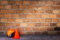 Construction helmet safety and cone Stock Images
