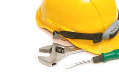 Construction Helmet with screw driver and wrench Royalty Free Stock Photos