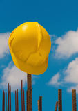 Construction helmet on steel bars Stock Photo