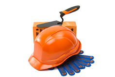 Construction helmet with steel trowel and gloves Stock Image