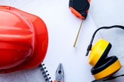 Construction helmet is a symbol of safety in the workplace. Set of tools. Safety concept Selective focus. Construction helmet is a symbol of safety in the stock photos