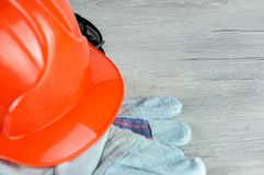 Construction helmet is a symbol of safety in the workplace. Set of tools. Safety concept Selective focus. DIY.  royalty free stock photos