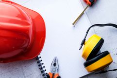 Construction helmet is a symbol of safety in the workplace. Set of tools. Safety concept Selective focus. Construction helmet is a symbol of safety in the stock photo