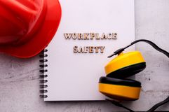 Construction helmet is a symbol of safety in the workplace. Set of tools. Safety concept Selective focus. Construction helmet is a symbol of safety in the royalty free stock photos