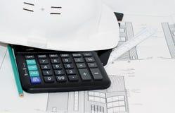 Construction helmet tools house plan blueprints Stock Photos