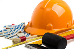 Construction helmet and tools on a white background Stock Photos