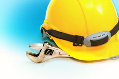 Construction Helmet with wrench stock photography