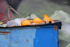 Construction helmets in the trash. Art Royalty Free Stock Images