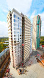 Construction of high building with workers Royalty Free Stock Image