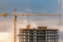 Construction of a high-rise building with a crane Stock Photo