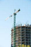 Construction of a high-rise building with a crane Royalty Free Stock Image