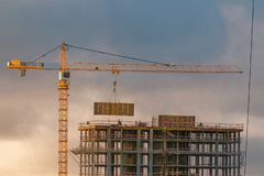 Construction of a high-rise building with a crane Royalty Free Stock Photos