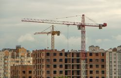 Construction of high-rise building tower crane Royalty Free Stock Images