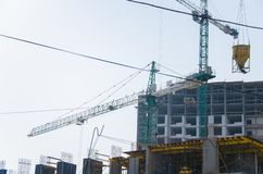 Construction of the building, erection of the frame. Construction of high-rise buildings, installation of formwork for concrete pouring, erection of the building royalty free stock image
