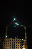 The construction of high-rise buildings at night in the spotligh Stock Photography